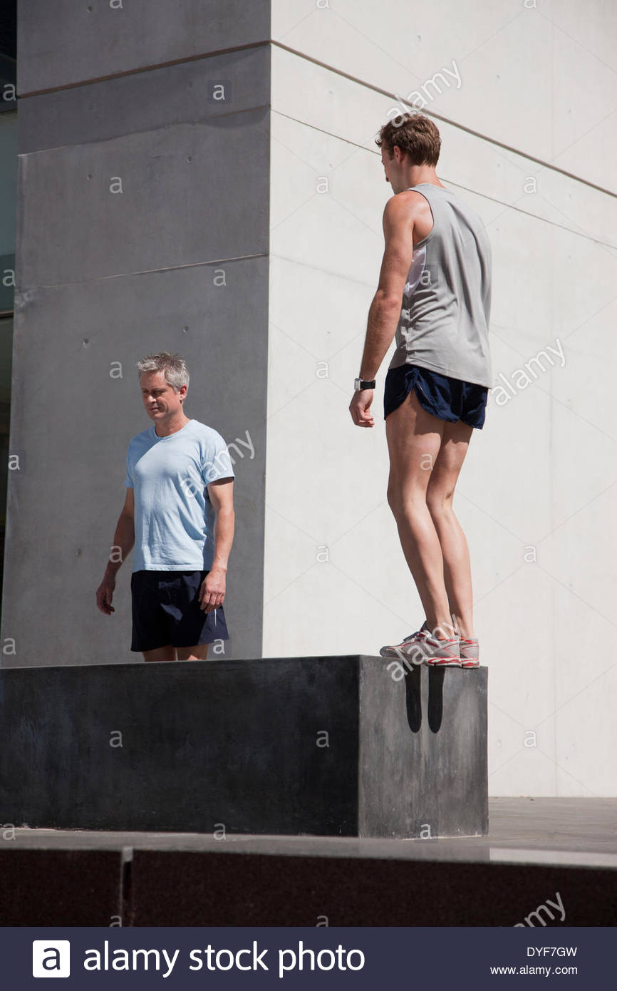 Friends stretching before exercise - Stock Image