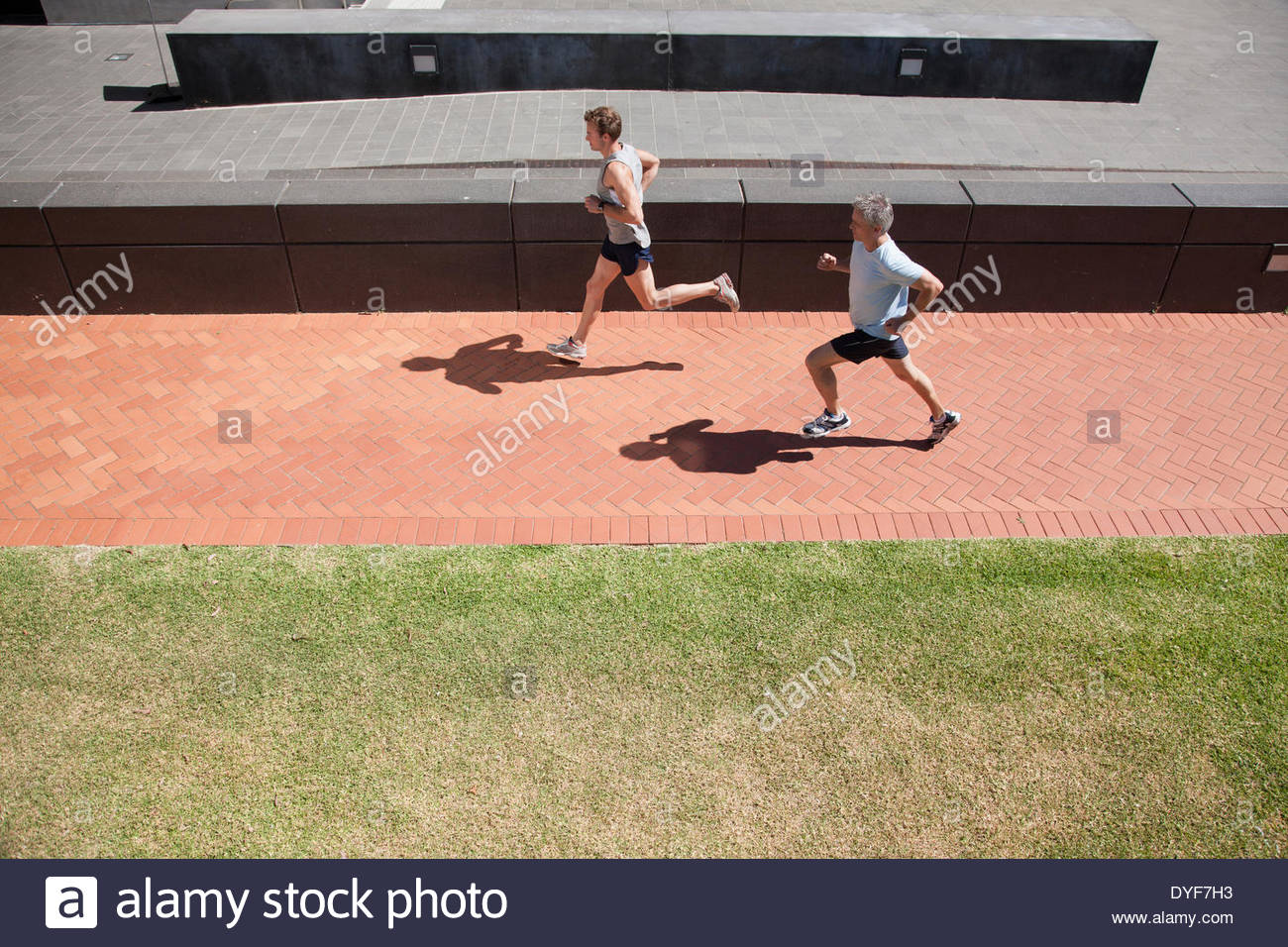 Two men running - Stock Image