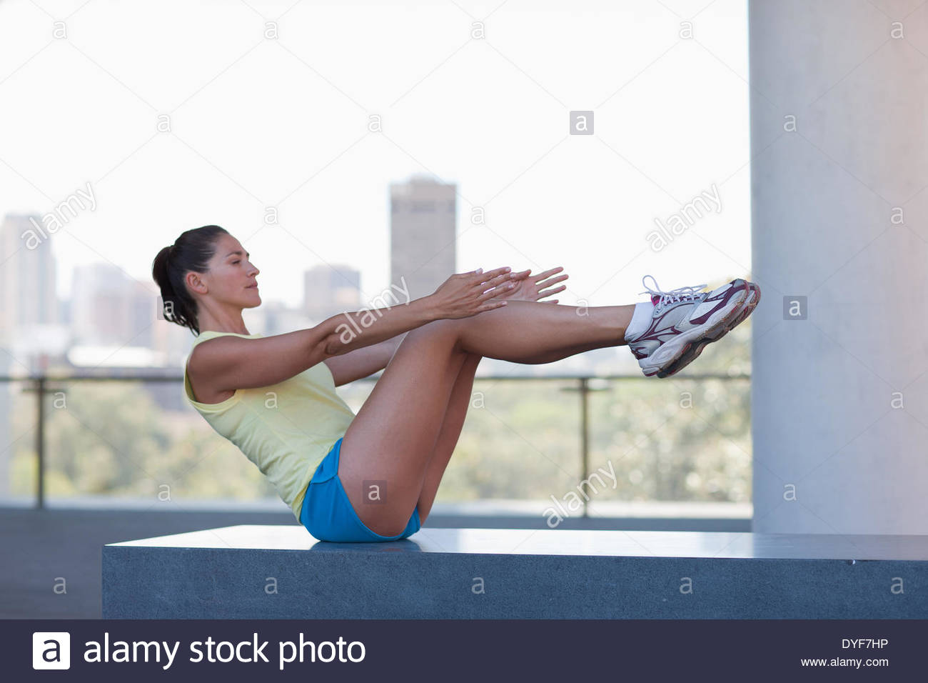 Woman stretching before exercise - Stock Image