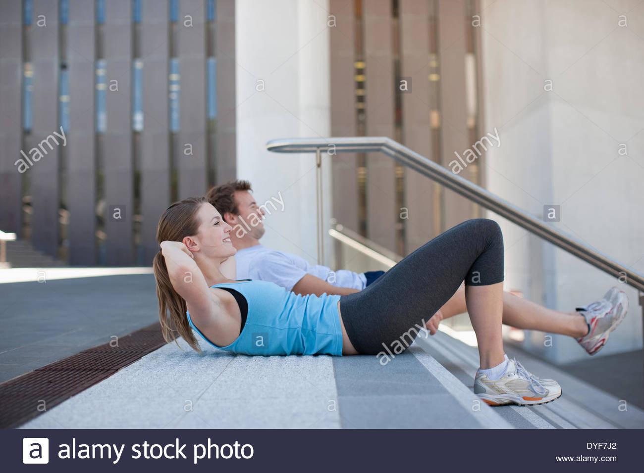 Couple resting after exercise - Stock Image