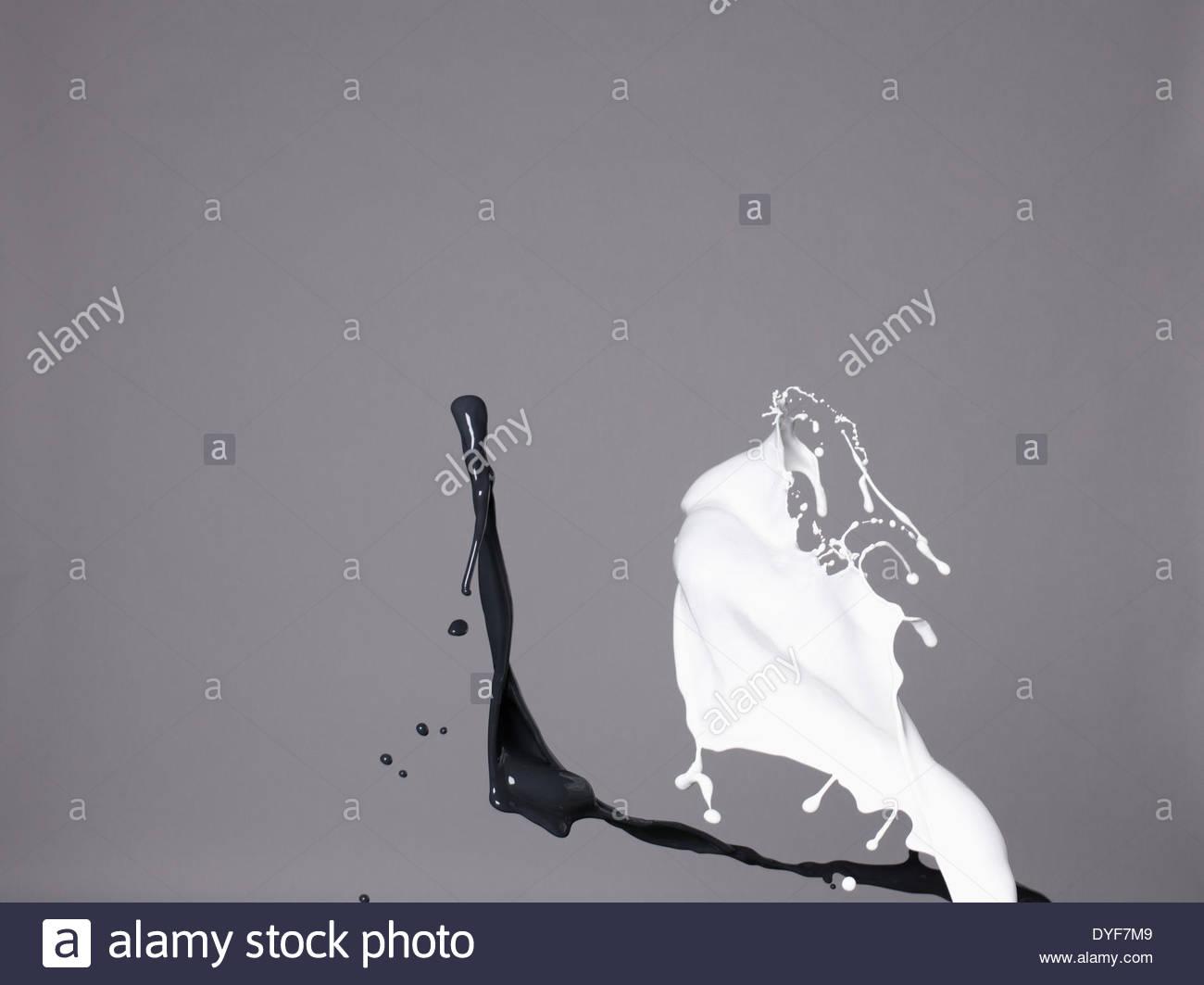 Black and white liquids splashing - Stock Image