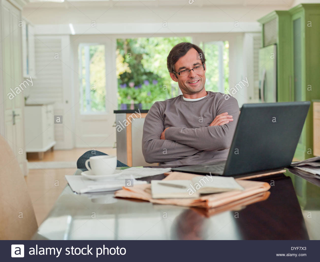 Man looking at laptop - Stock Image