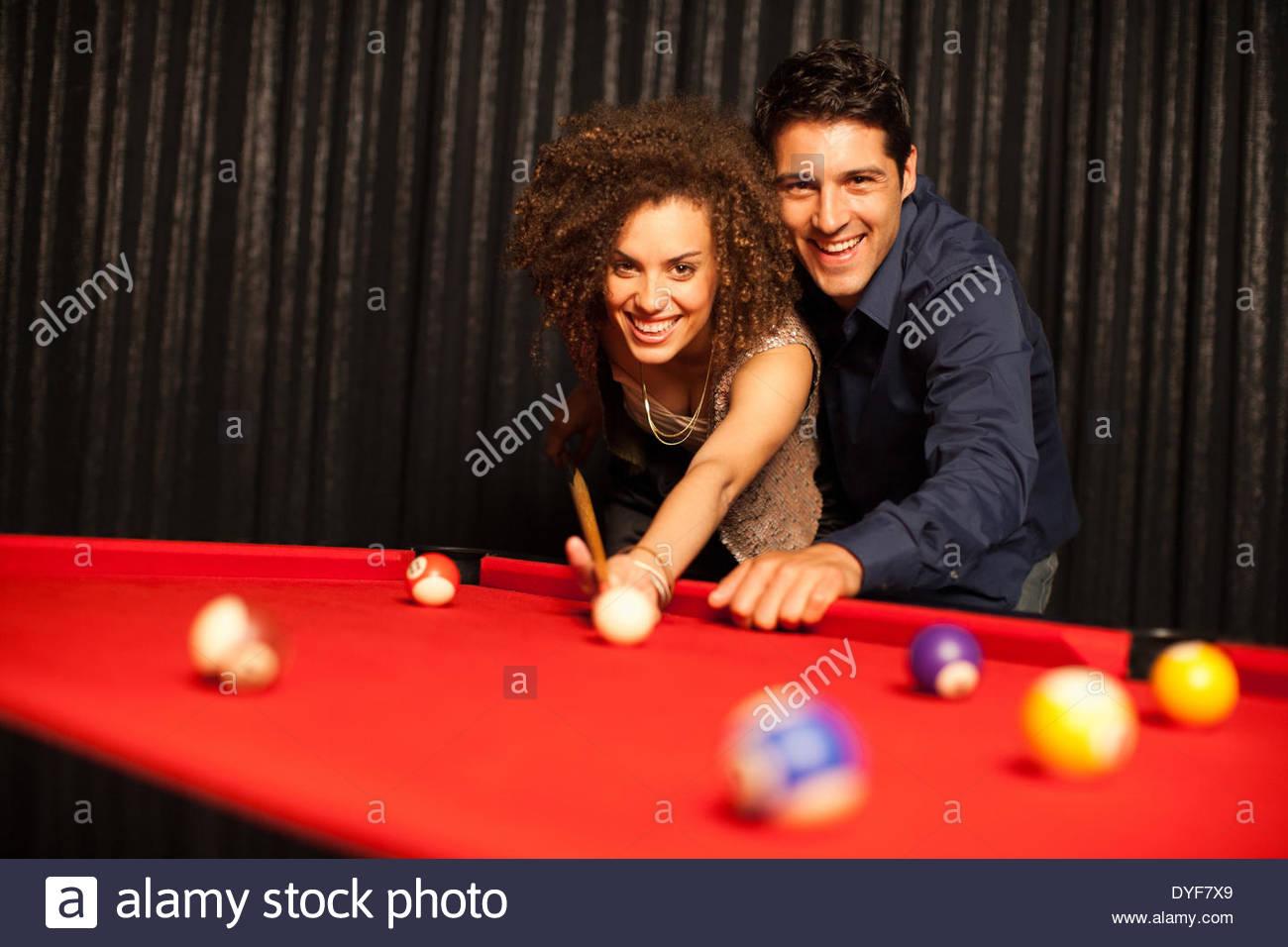 Couple playing pool - Stock Image