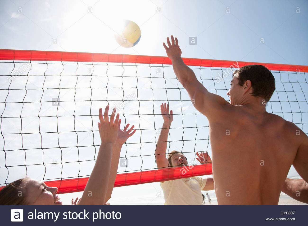 Friends playing volleyball - Stock Image