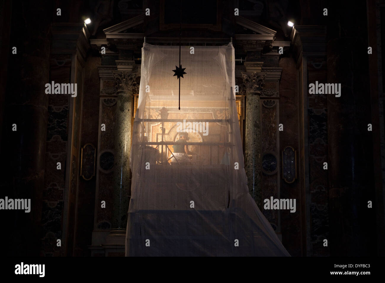 A conservator working restoring artworks in St. Peter's Basilica in Rome - Stock Image