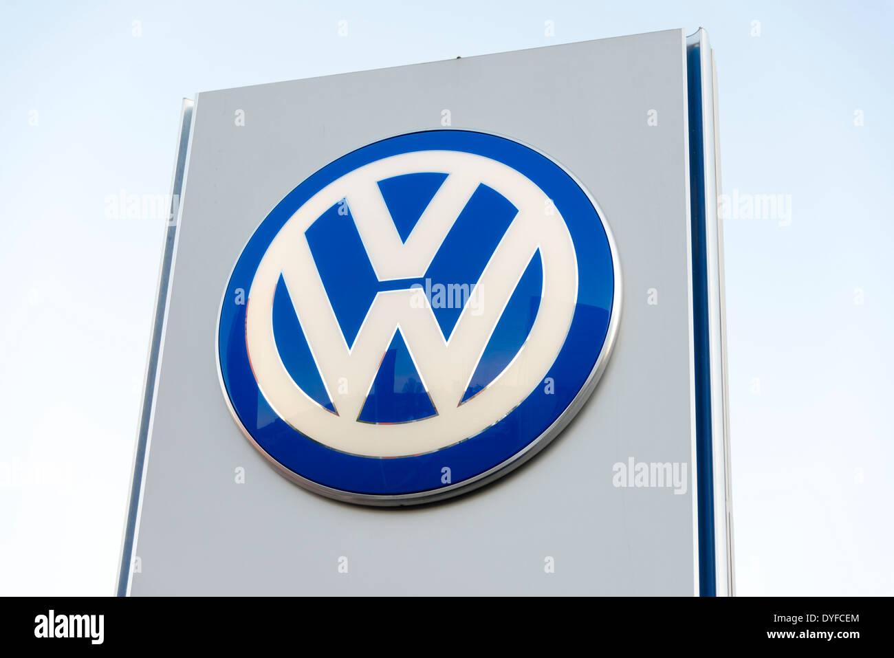 VW sign at a garage, UK. - Stock Image