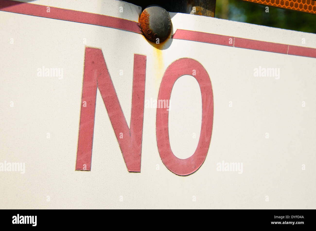 Tight shot of the word no on a street sign. - Stock Image