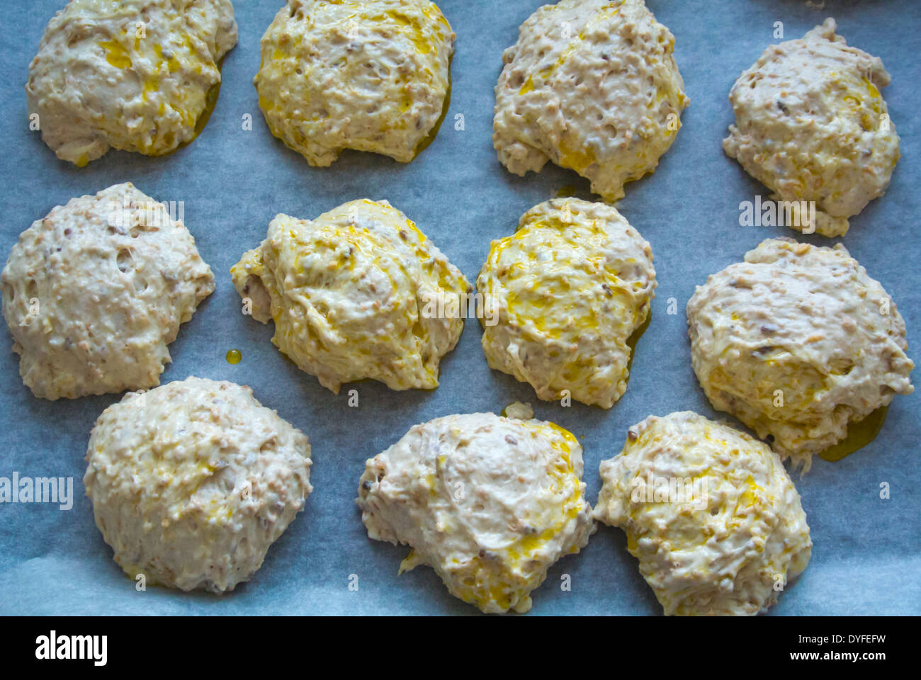 Raw dough bread rolls before going into the oven, Finland, Europe - Stock Image