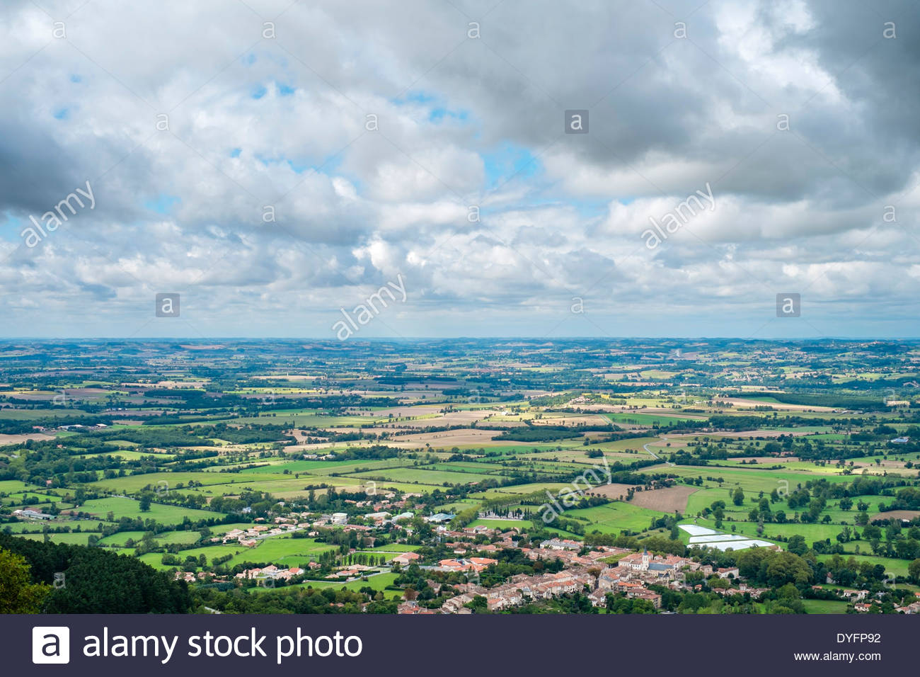 View overlooking farmland in valley, near Dourgne (lower right), Tarn Department, Midi-Pyrénées, France - Stock Image