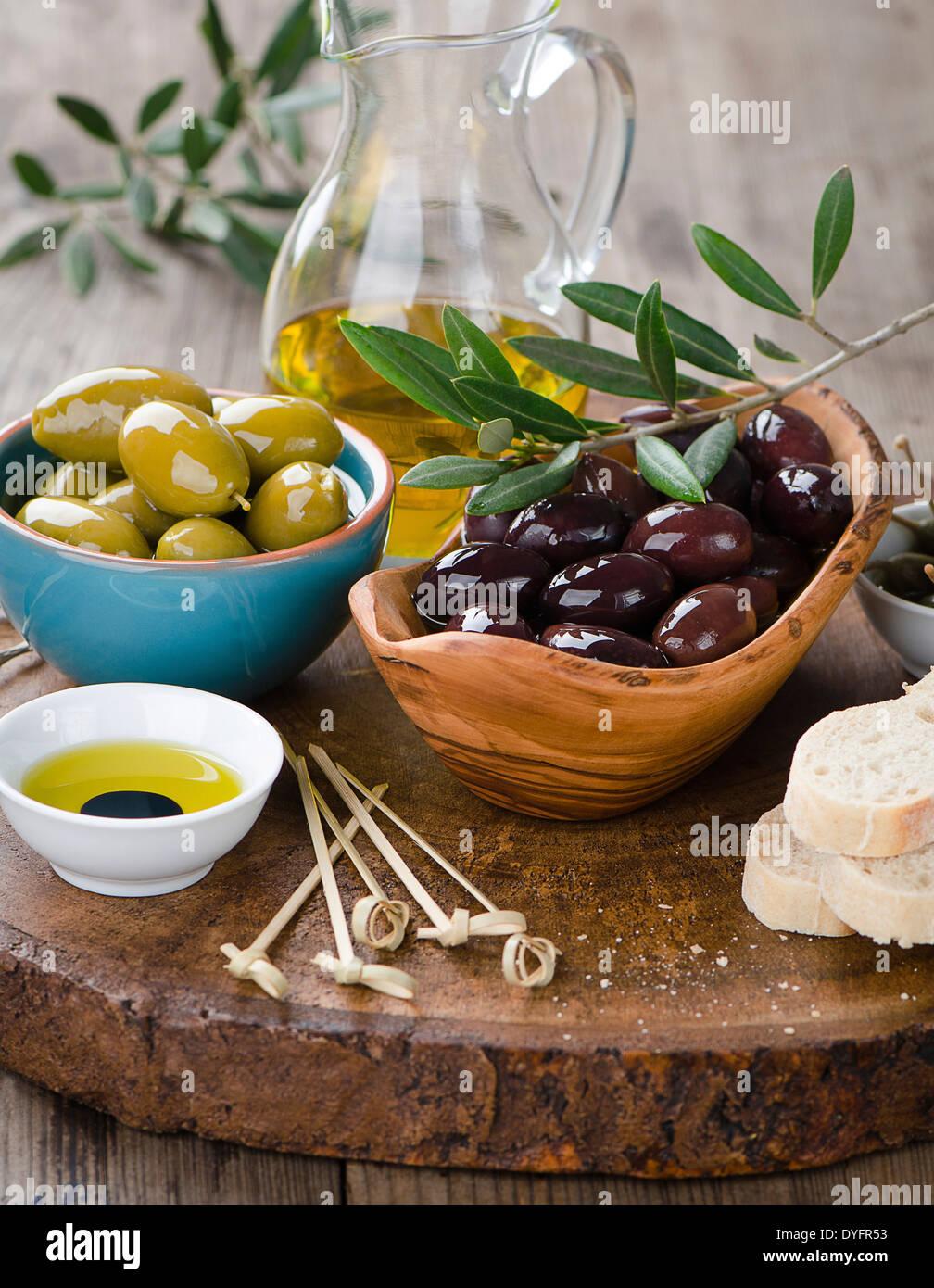 Fresh olives and olive oil platter - Stock Image