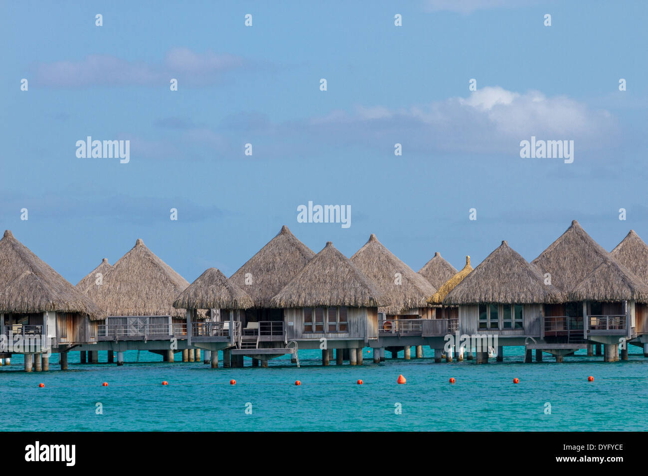 Overwater Bungalows With Turquoise Water In Bora Bora