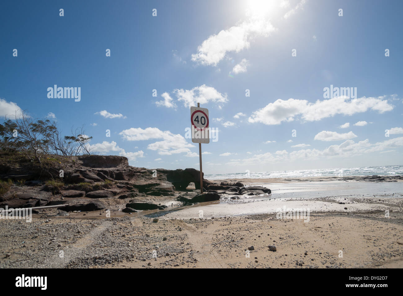 Driver speed restriction sign on Fraser Island, Ten Mile beach in March 2014. - Stock Image