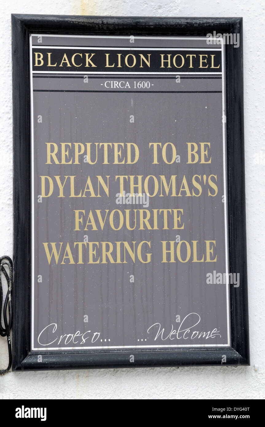 Sign outside The Black Lion Pub New Quay reputed to be Dylan Thomas favourie watering hole Ceredigion Wales Cymru - Stock Image