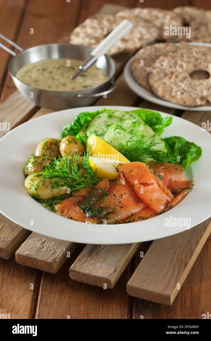 Gravlax salad with crispbread Swedish food - Stock Image