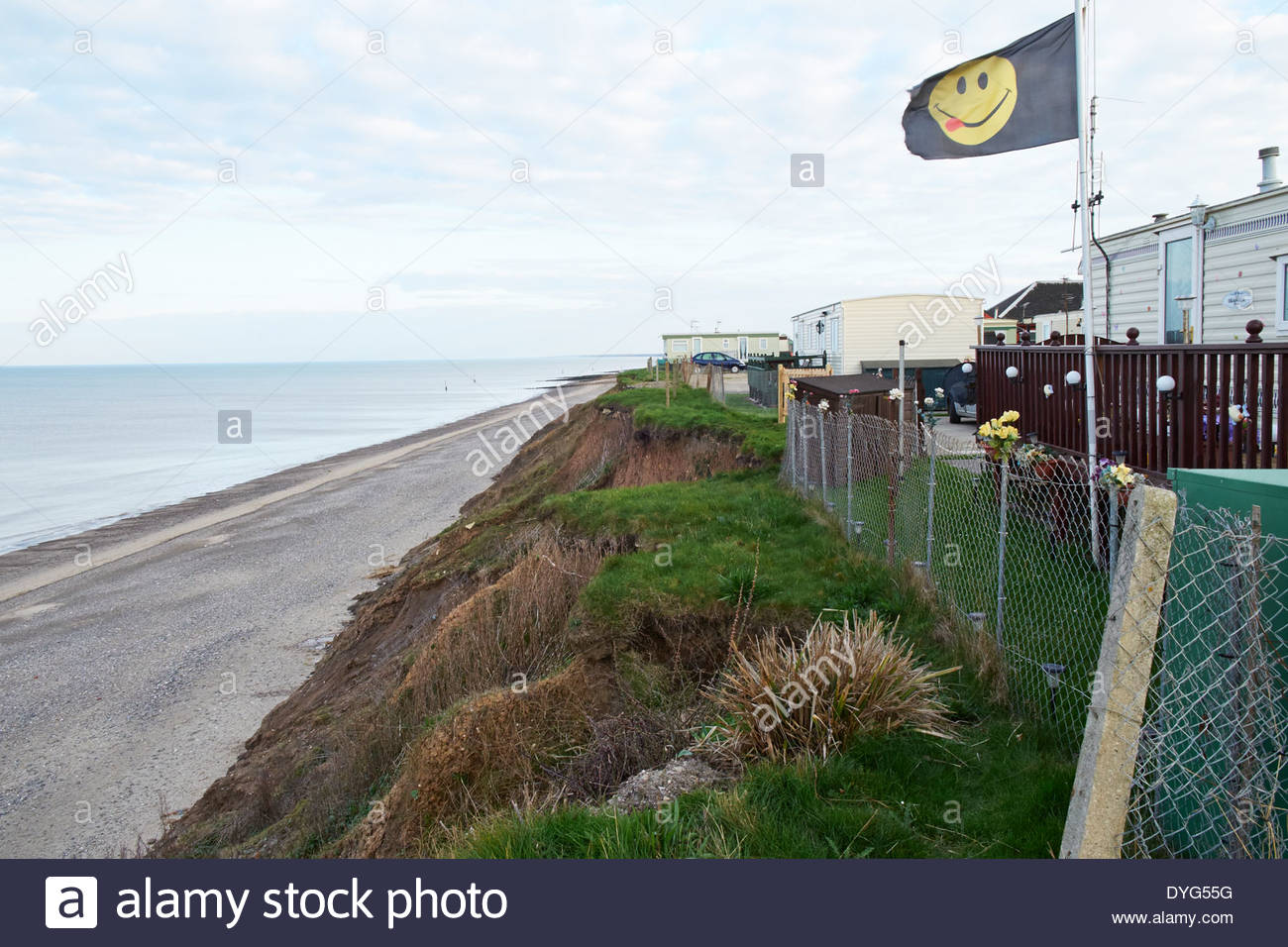 Mobile Homes on camp site under threat  from erosion, landslip. Clay cliffs at Hornsea, Holderness Coast - erosion by sea action - Stock Image