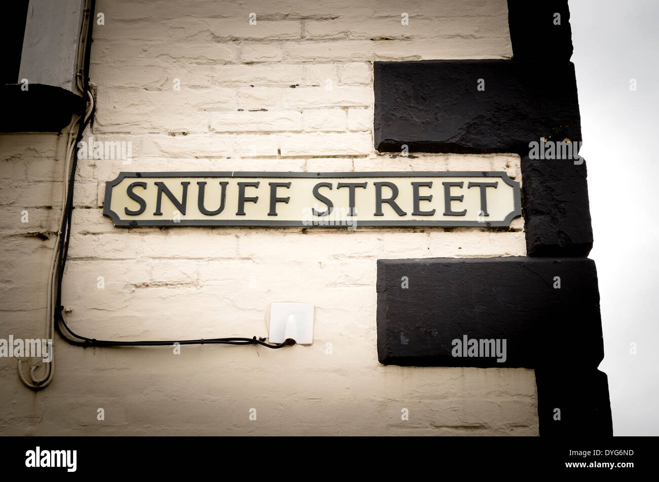 SNUFF STREET name plate in English town reflecting