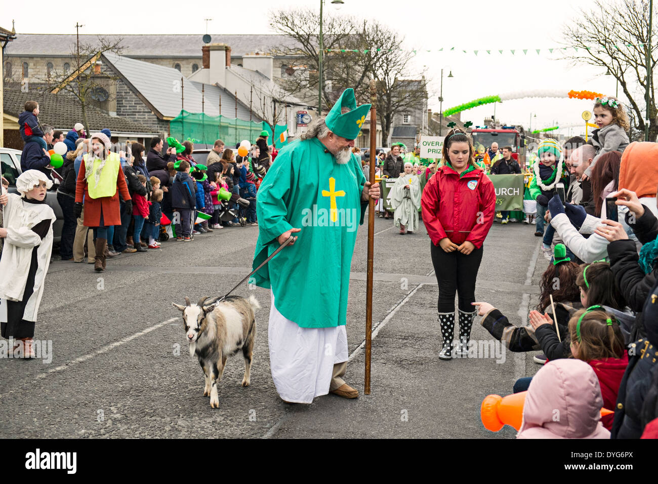 St Patrick's Day parade - Patrick with his goat. Local legend in Skerries,  Dublin, Ireland says the villagers ate his goat - Stock Image