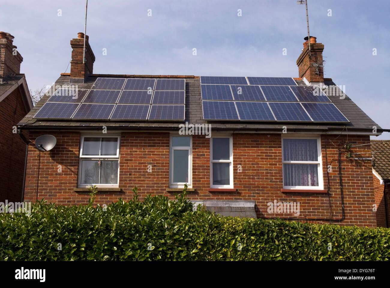 House with solar panels on roof, Lindford, near Bordon, Hampshire, UK. - Stock Image