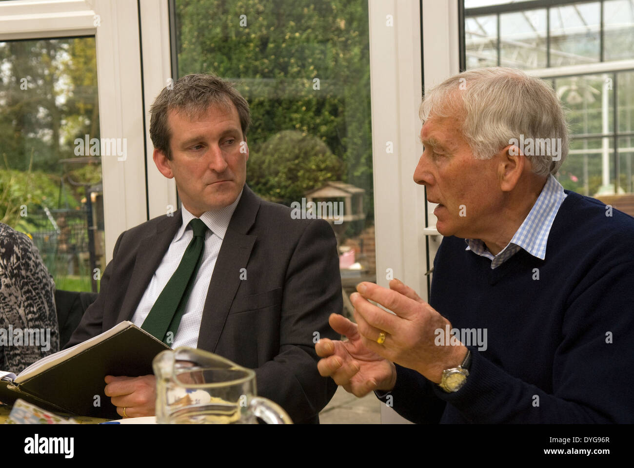 Damian Hinds (left), MP for East Hampshire, listening to an NFU member during a breakfast meeting with members of the NFU - Stock Image