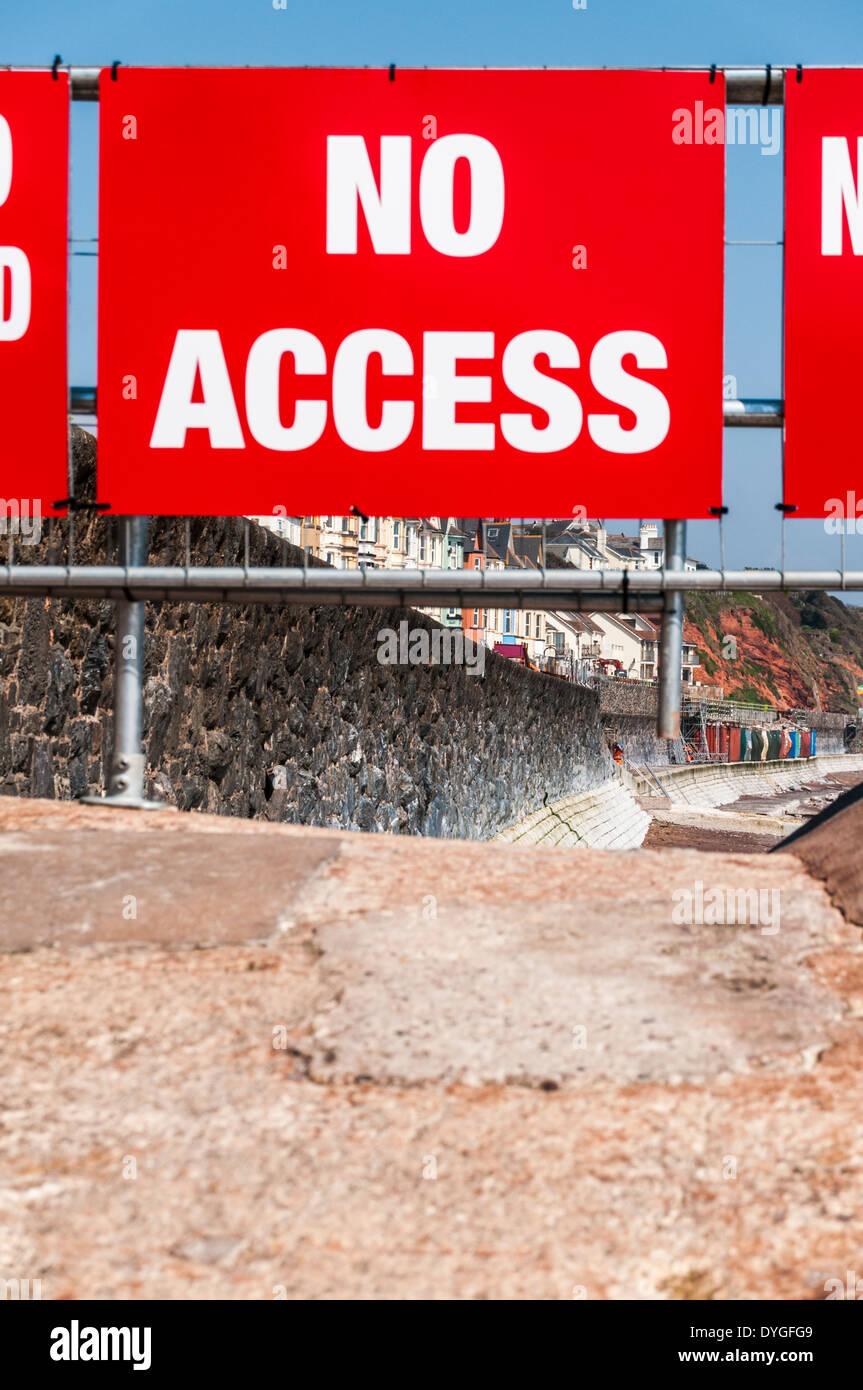 No access warning sign preventing access to the damaged seawall at Dawlish. - Stock Image