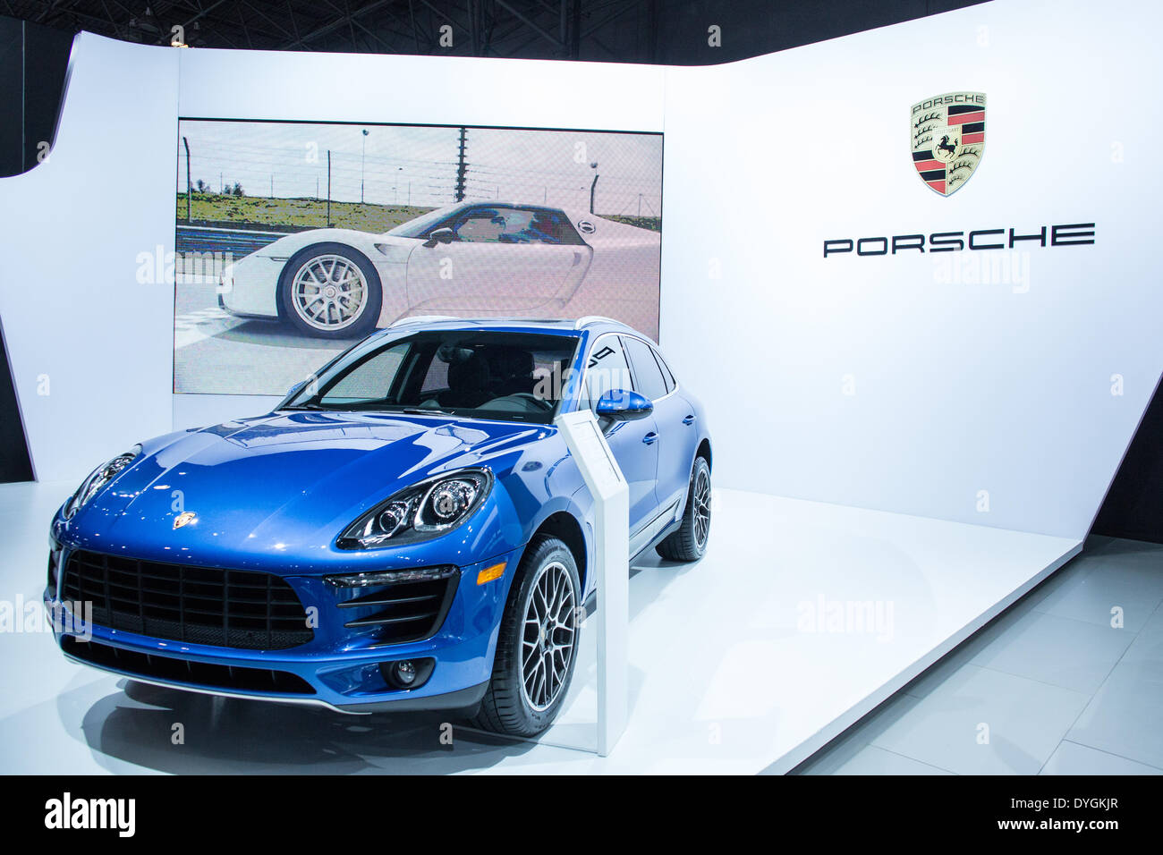 New York, USA. 16 April 2014. Porsche shows its 2015 Macan S, a 5-door, 5-seat hatchback. Porsche also brought several of its sportier models to the show. Credit:  Ed Lefkowicz/Alamy Live News - Stock Image