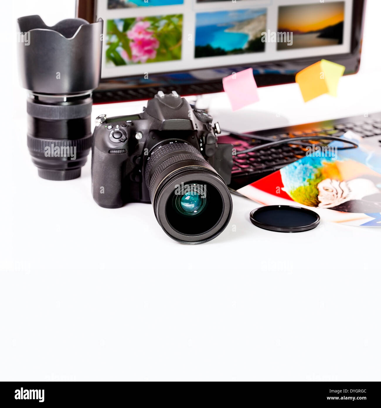 Photography concept. Digital camera, monitor and photos on white background. - Stock Image