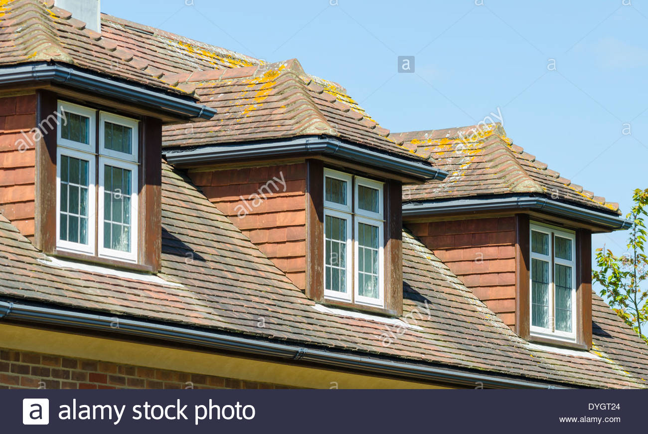 Dormer windows on a house. - Stock Image