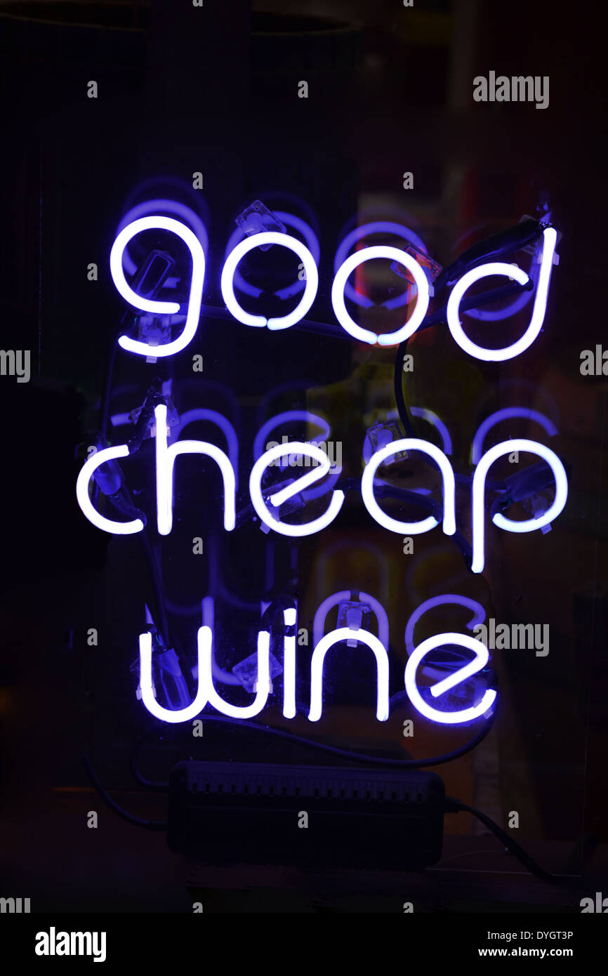 A white neon sign reading Good Cheap Wine - Stock Image