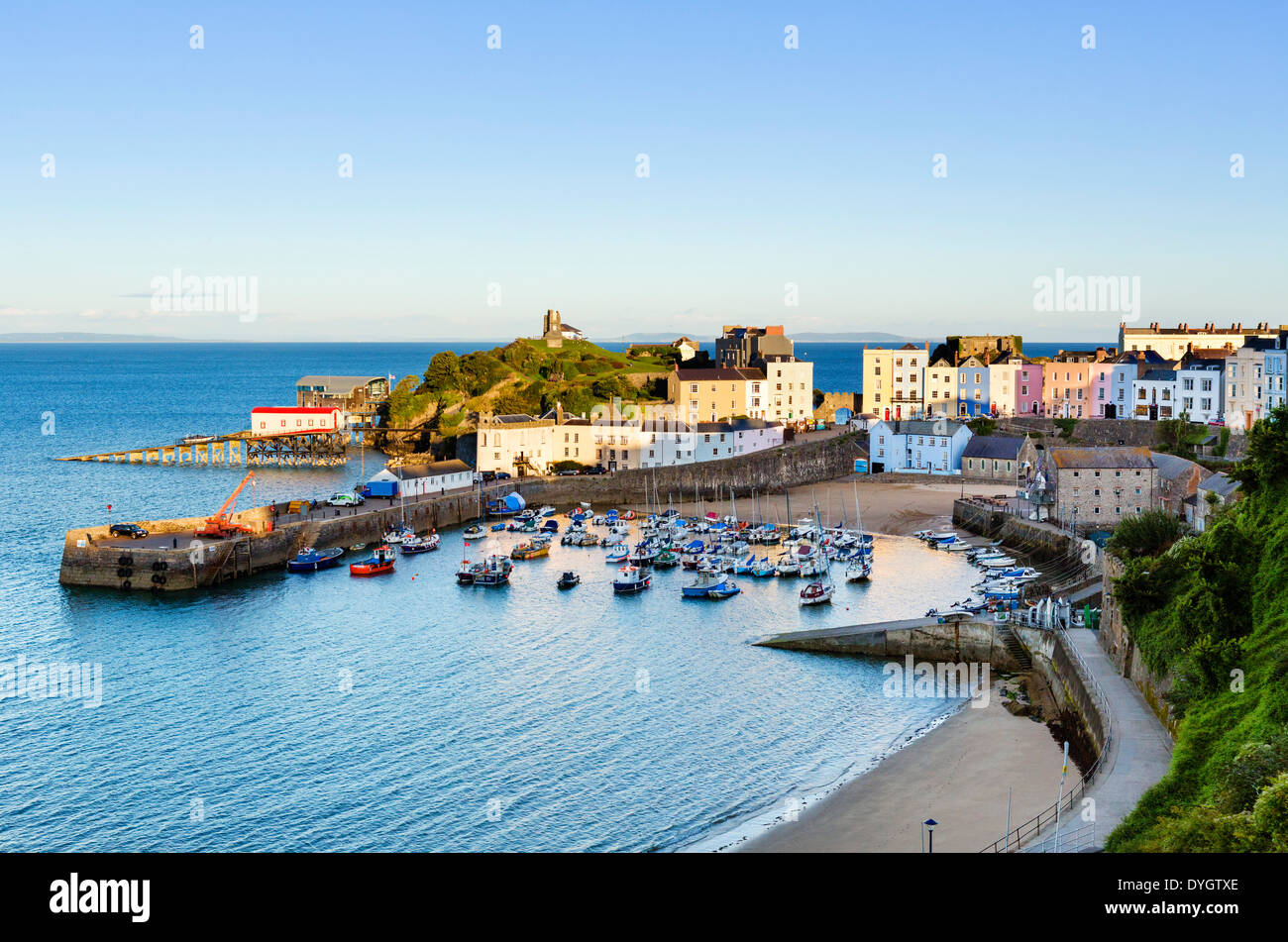 View over the harbour at high tide in the early evening, Tenby, Carmarthen Bay, Pembrokeshire, Wales, UK - Stock Image