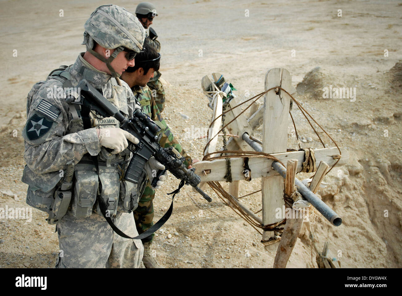 A US soldier investigates a primitive digging device just west of Forward Operating Base Ramrod December 24, 2009 Stock Photo
