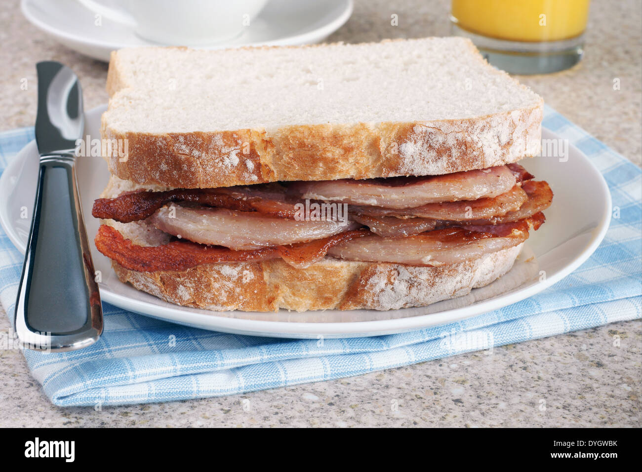 Bacon Sandwich or bacon butty selective focus on the bacon - Stock Image