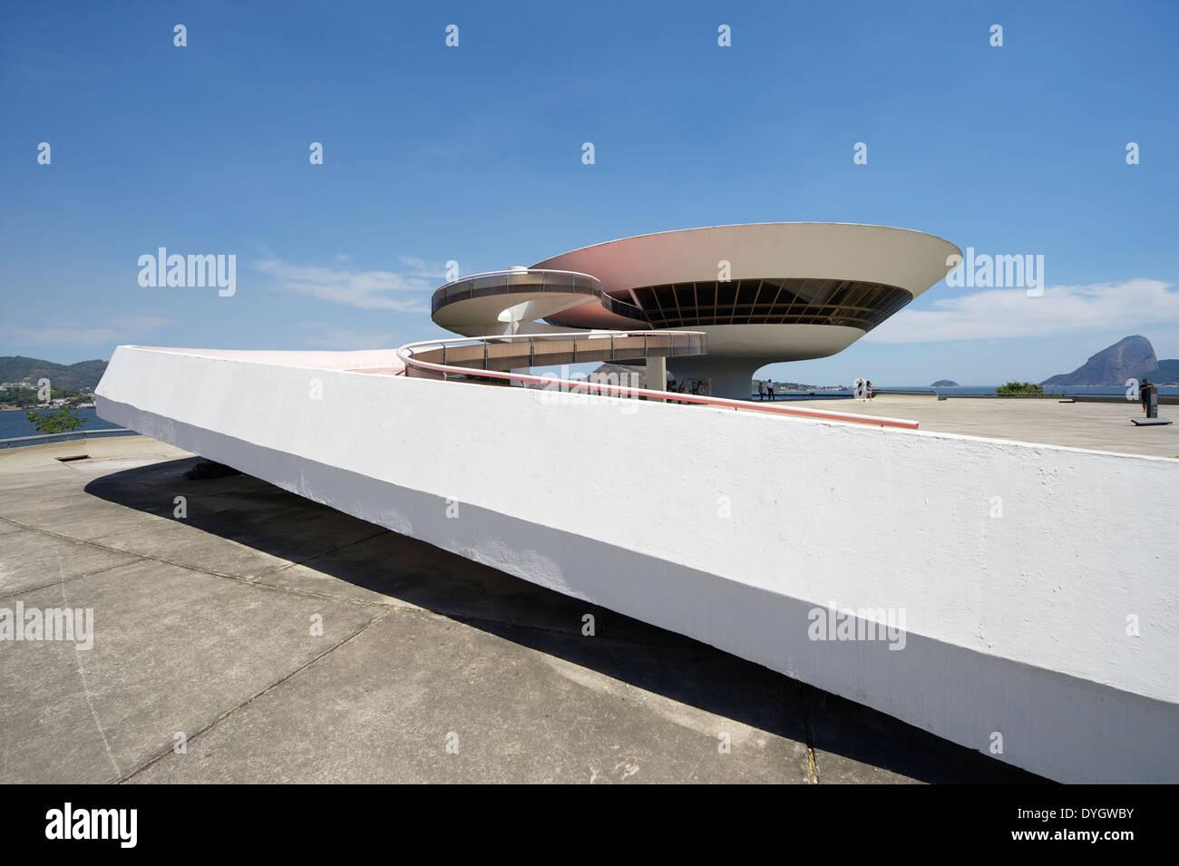 RIO DE JANEIRO, BRAZIL - FEBRUARY 4, 2014: The modernist Niteroi Contemporary Art Museum (MAC) by Oscar Niemeyer features a ramp - Stock Image