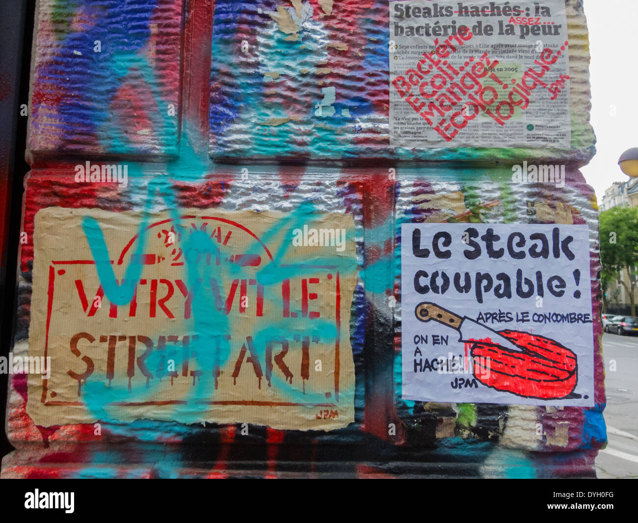 Paris, France, French Graffitti Artist Painting Wall, Posters Organic Food - Stock Image