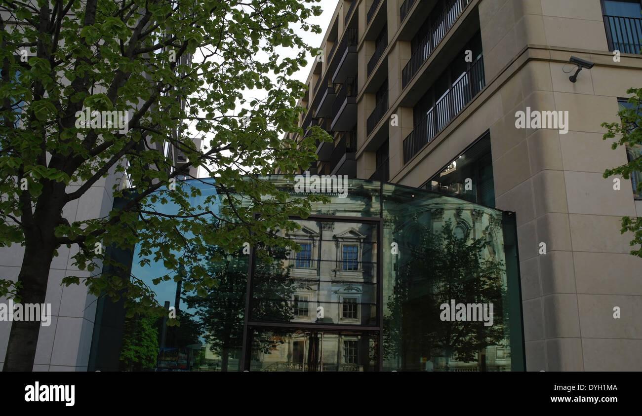 Sunny view Berliner Dom reflecting in glass doors of Radisson Blu Hotel, Spreepromenade, Berlin, Germany - Stock Image
