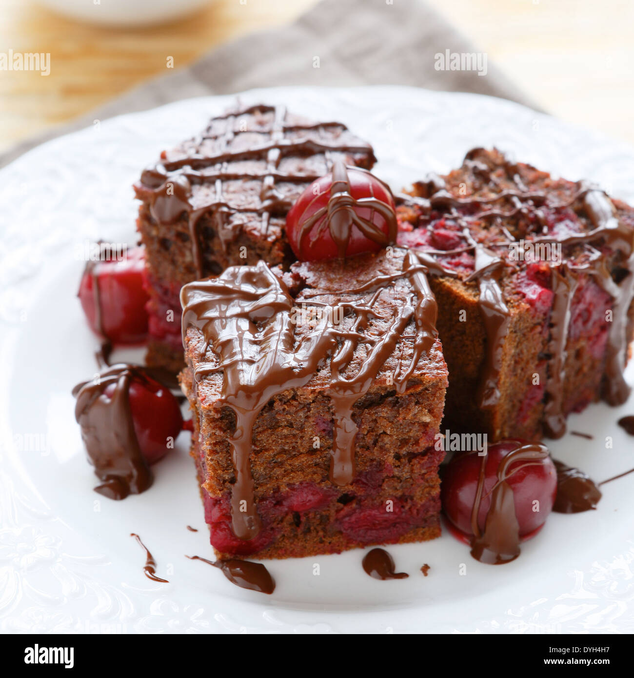 brownie slices with cherries, food closeup - Stock Image