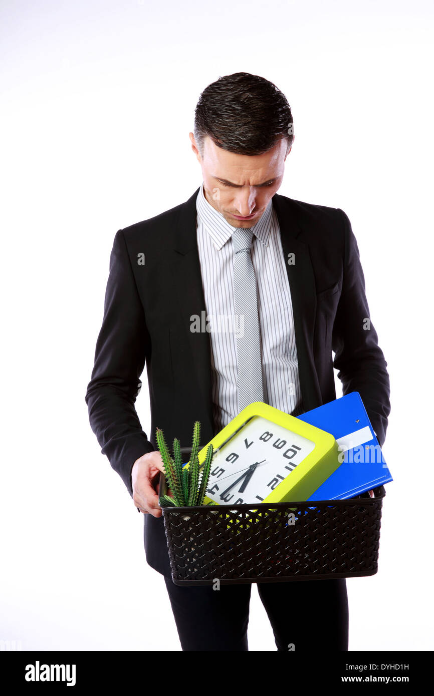 You are fired! Businessman hold box with personal belongings on gray background - Stock Image