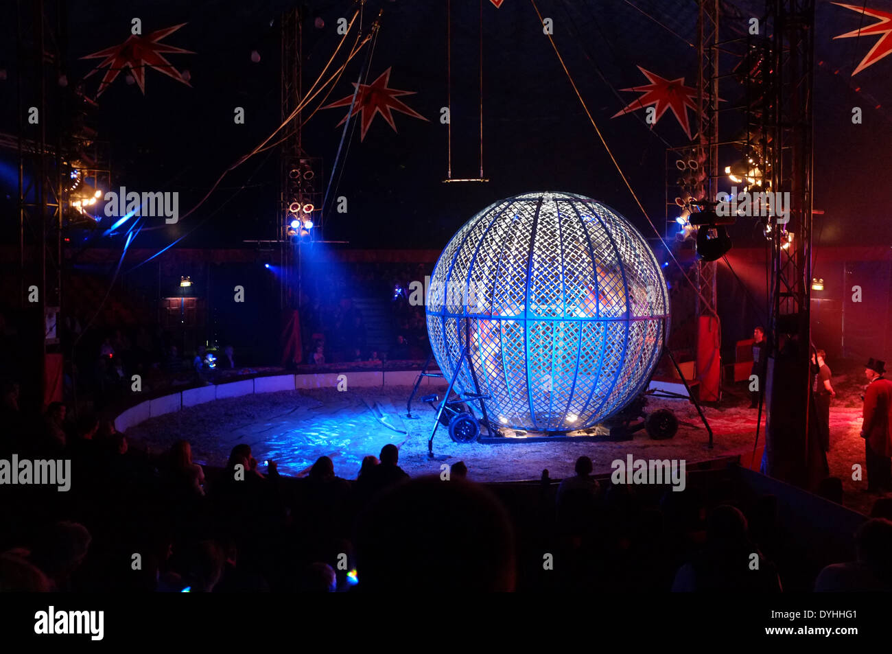 Two motorbikes inside a steel cage during a circus show performing loops inside the cage. The circus was travelling through Bannockburn in Scotland - Stock Image