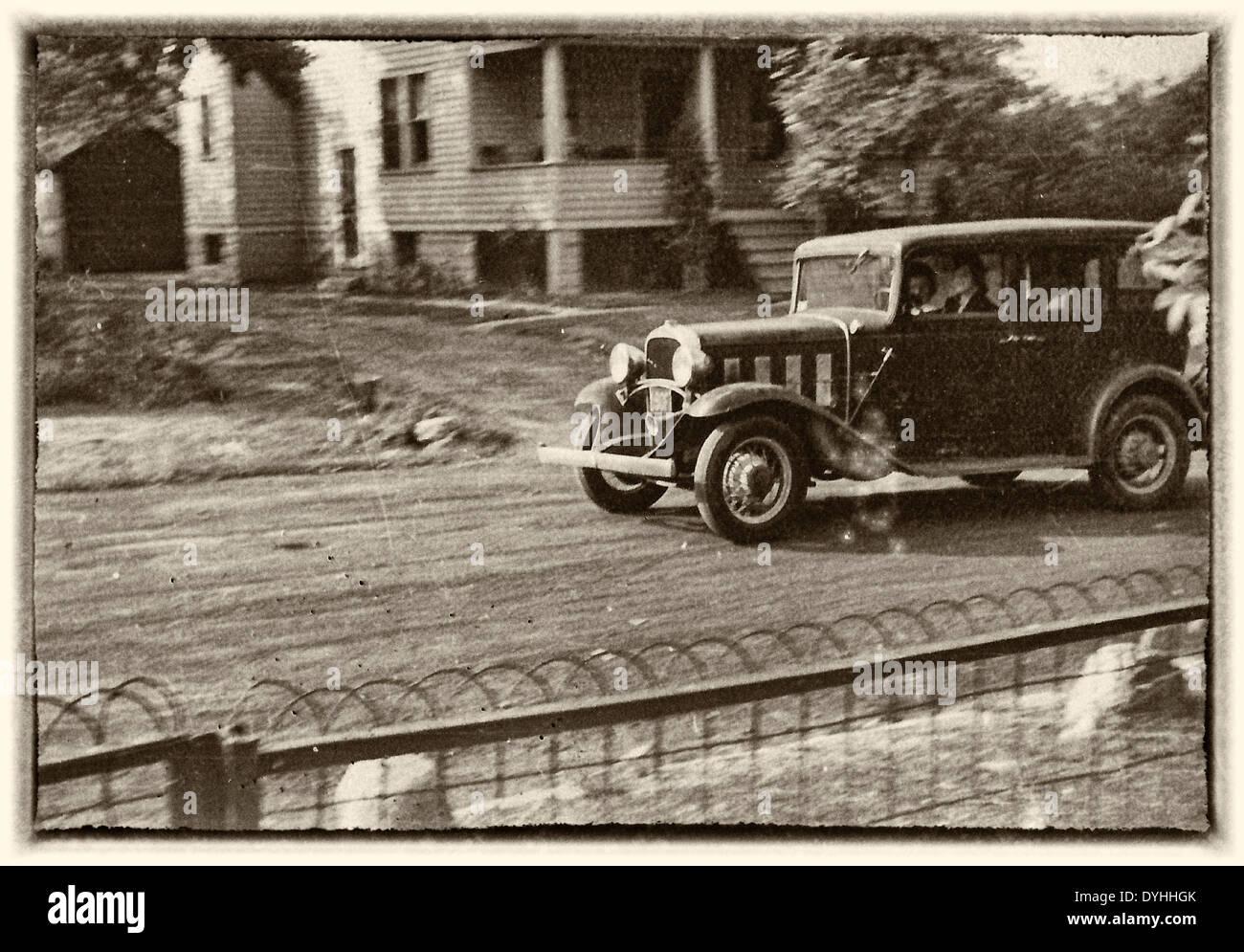 Woman driving car, circa 1940 - Stock Image