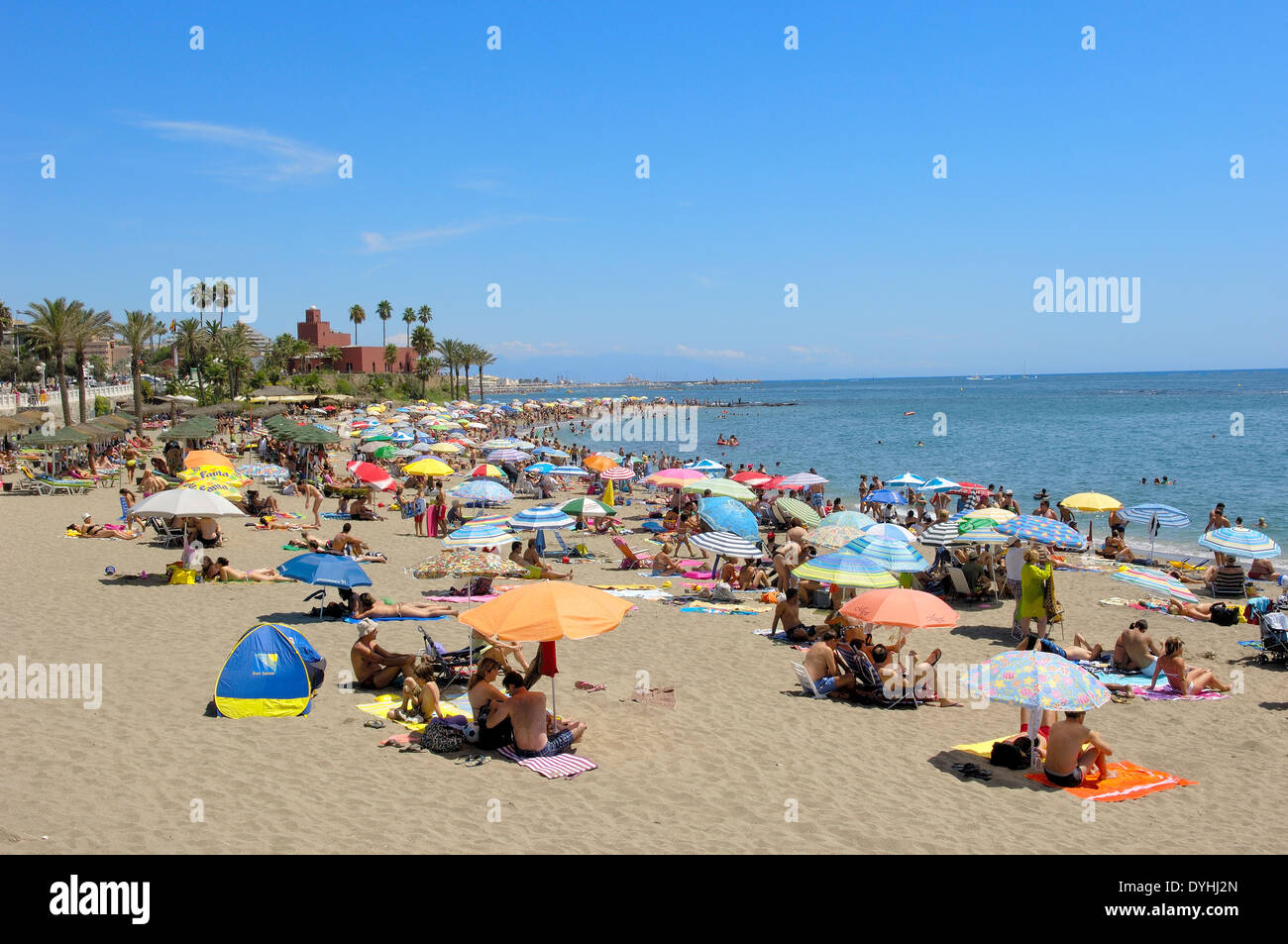 Beach and Bil-Bil castle at background, Benalmadena. Malaga province, Costa del Sol, Andalucia, Spain - Stock Image