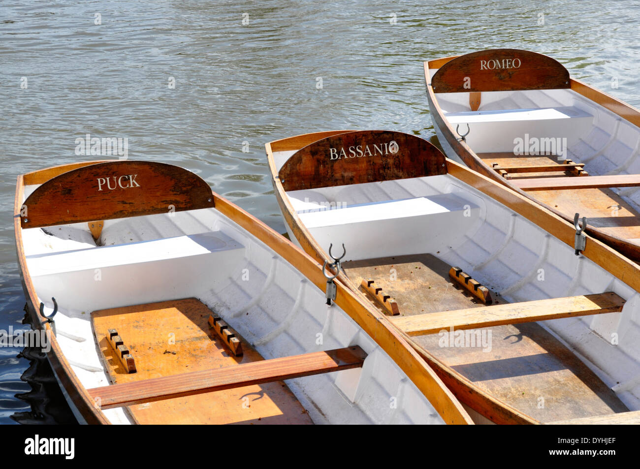 Stratford on Avon - by the river - rowing boats for hire - each boat named after a Shakespearean character - bright sunshine - Stock Image