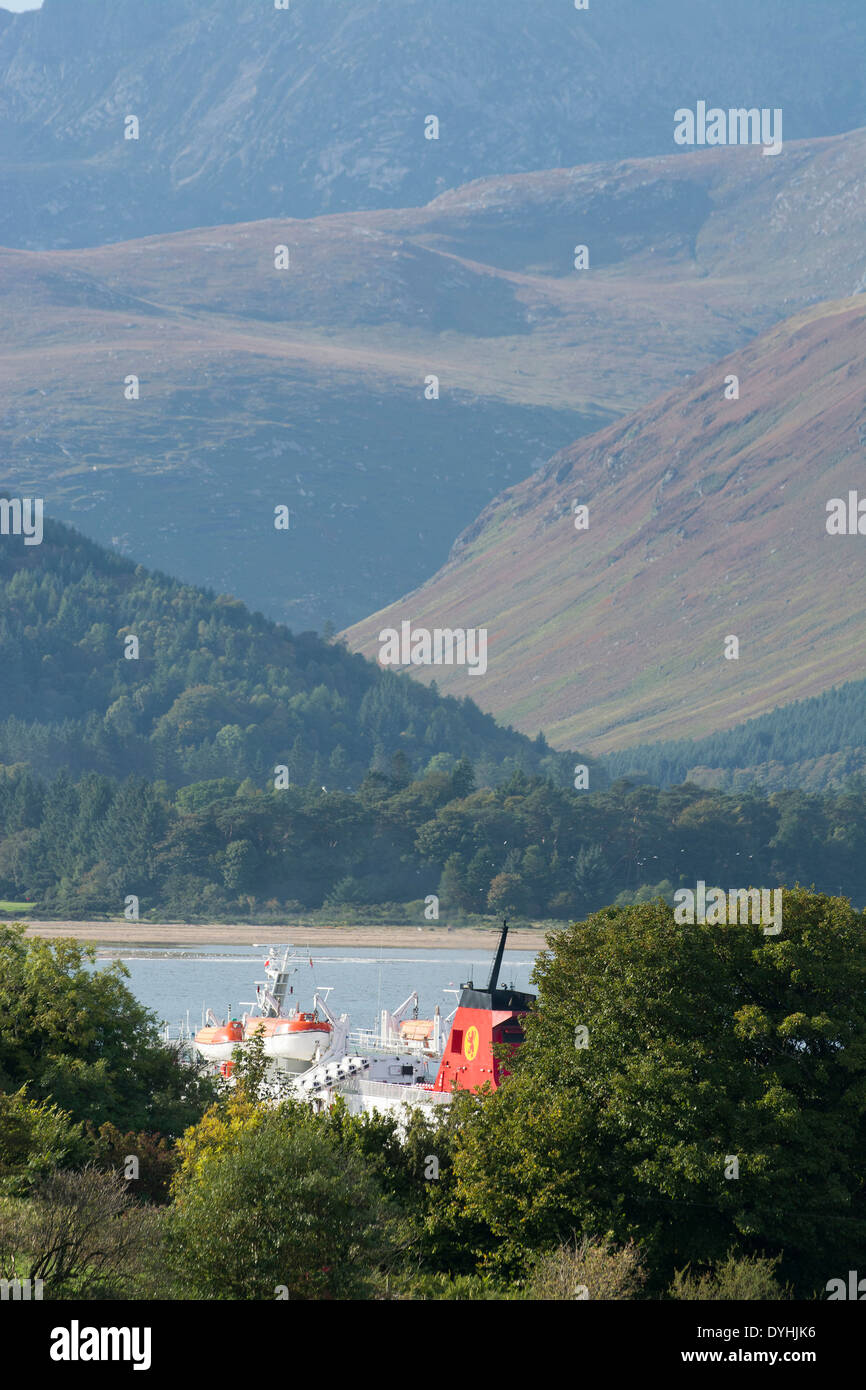 glimpse of calmac ferry funnel at brodick isle of arran - Stock Image