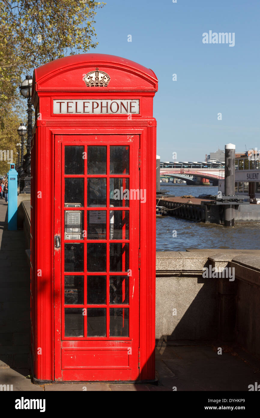 Traditional old red telephone box, London, England, UK - Stock Image
