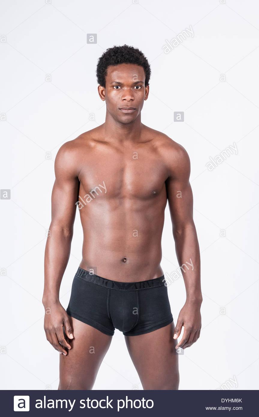 Afro man portrait posing on a photo studio, Paris, France. Stock Photo