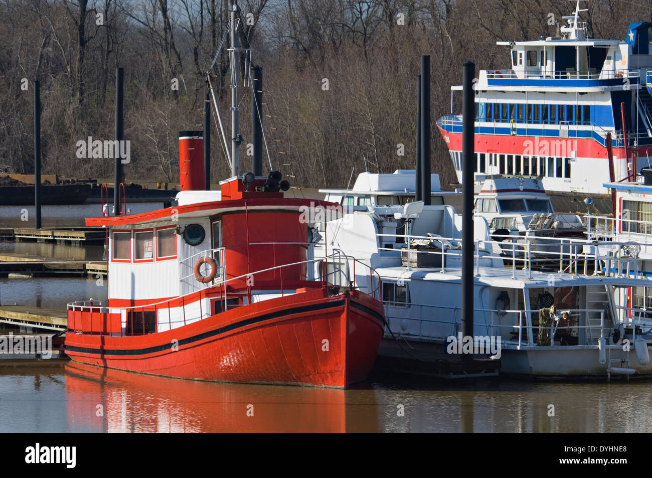 Tug Boat and its Reflection Reflection on the Ohio River in Utica, Indiana - Stock Image