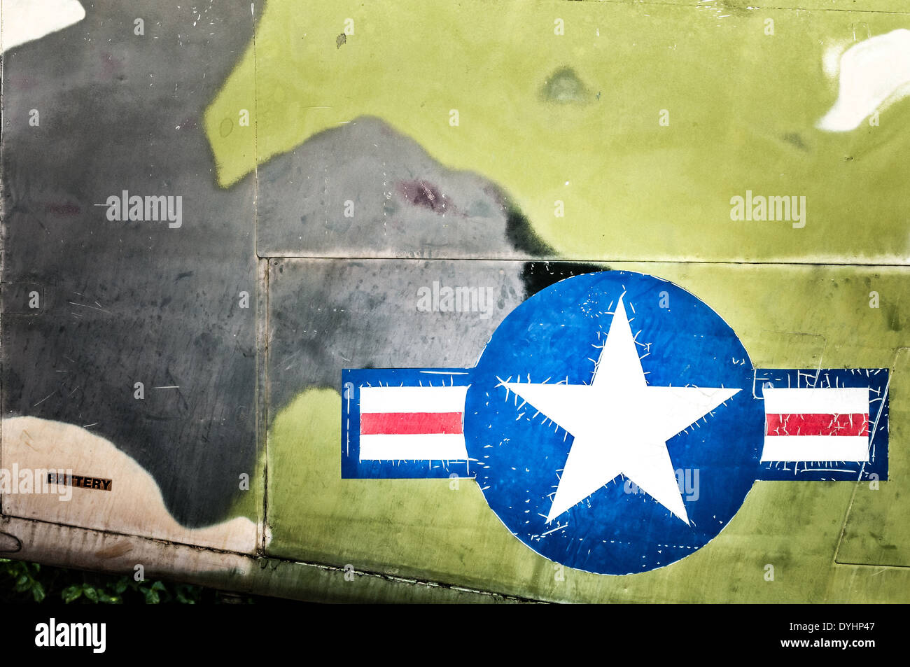 Part of military airplane with United States Air Force sign. Big white star in blue circle with stripes aside. - Stock Image