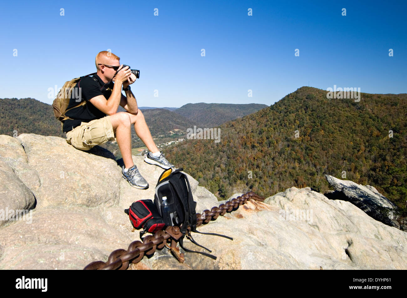 Tourist with Camera Sitting on Top of Chained Rock at Pine Mountain State Park in Bell County Kentucky Stock Photo