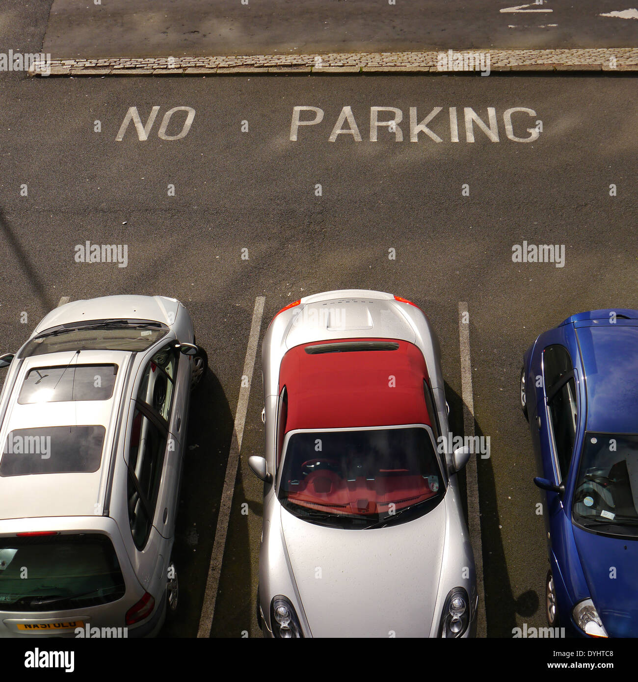 Bird's eye view of parked cars in car park, set against 'No Parking' sign, Newcastle upon Tyne, England, UK - Stock Image