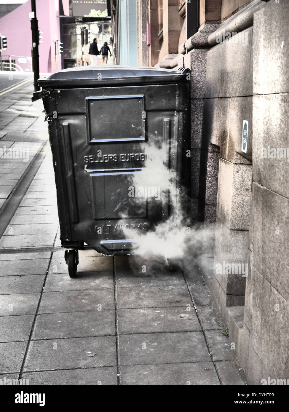 Creative / artistic photographic image of wheelie refuse bin and steam vent in City street, Newcastle upon Tyne, England, UK - Stock Image