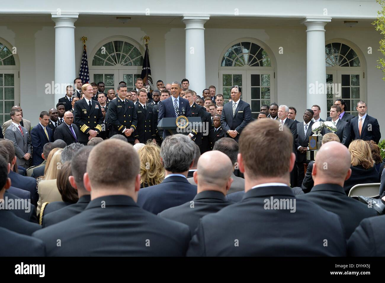 US President Barack Obama congratulates the US Naval Academy football team during an event on the South Lawn of the White House April 18, 2014 in Washington, D.C. The president presented the Navy Midshipmen with the Commander-in-Chief's Trophy, which goes to the Department of Defense academy team with the most victories against its Service rivals. - Stock Image