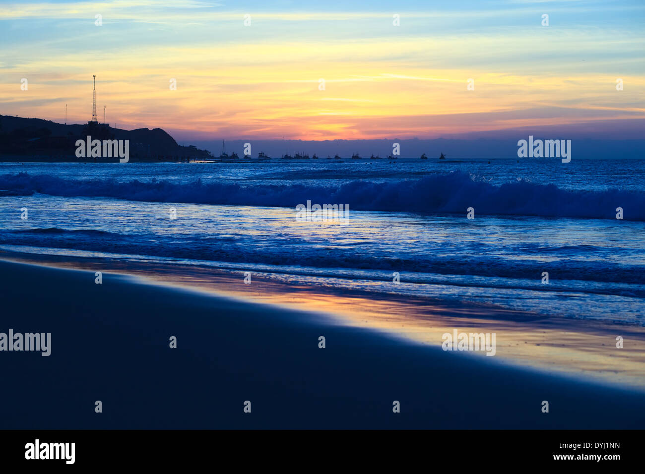 The sandy beach of Mancora in Peru shortly after sunset - Stock Image